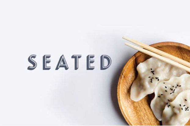 image of seated logo with dumplings on a plate