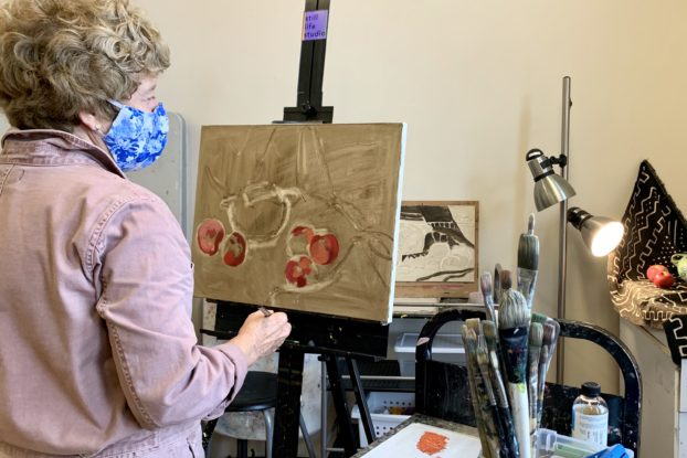 Adria Moynihan Rusk, owner of Still Life Studio, painting.