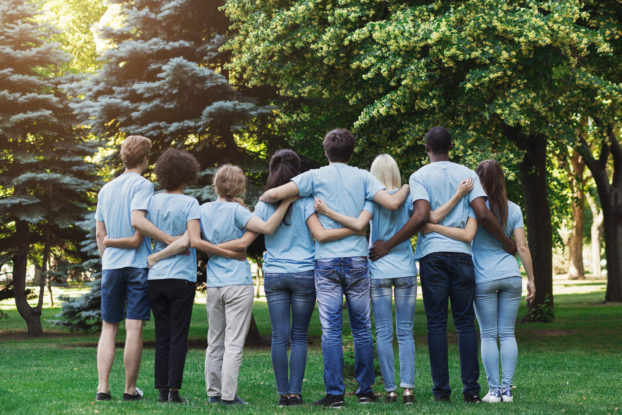 group of volunteers with their arms around each other