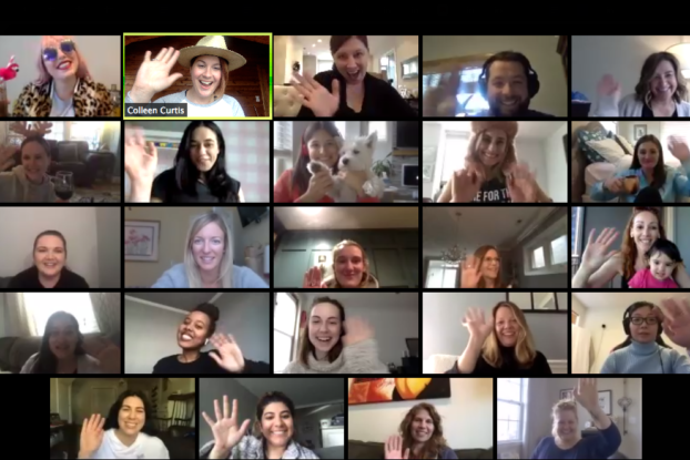 Smiling women participate in a virtual meeting