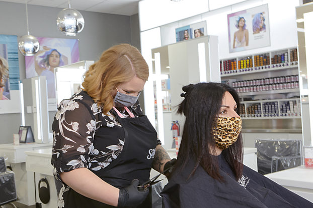 woman getting her hair done with mask on at ulta salon