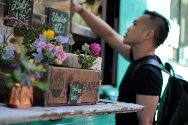 Customer purchasing flowers from Uprooted Flower Truck.