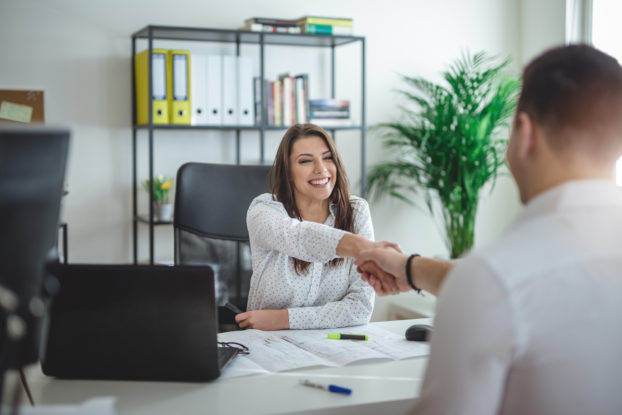 woman interviewing man in office