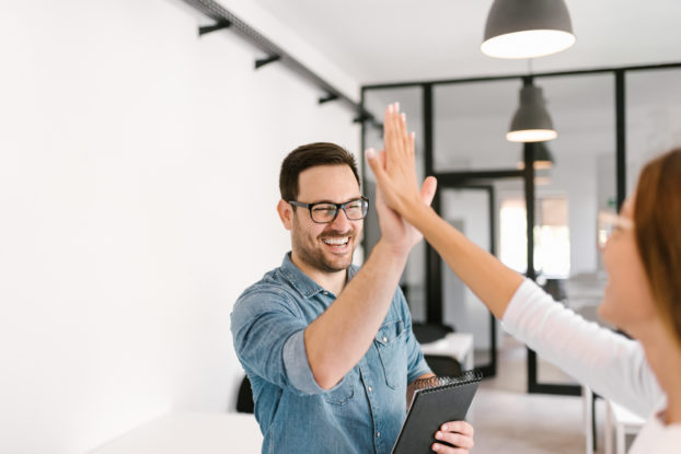 two colleagues high-fiving