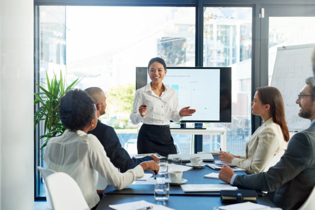 woman giving presentation to other professionals