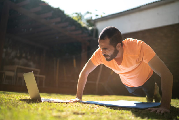 man outside doing virtual workout