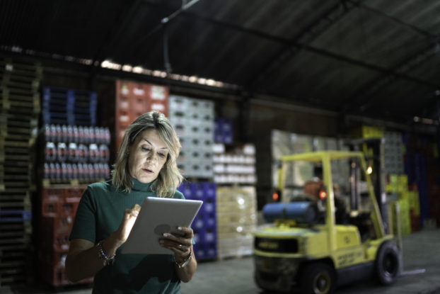 woman working on tablet in warehouse