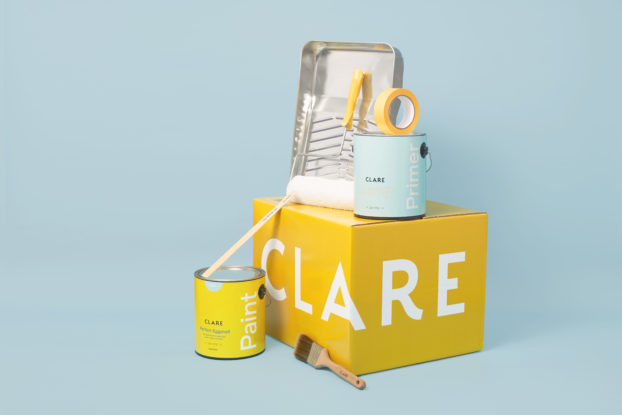 clare product display with box and paint cans and materials