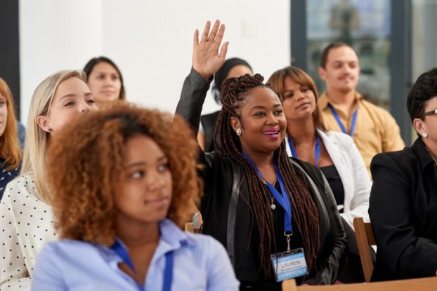 Employee raising hand in meeting