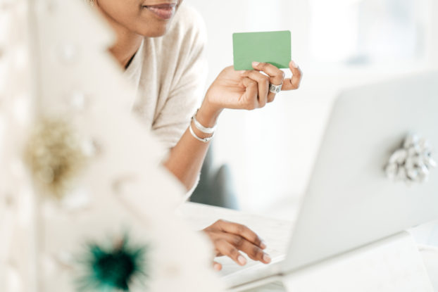 woman shopping online with card