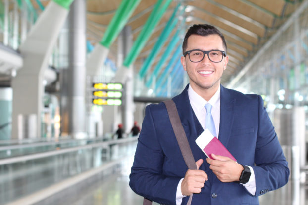 Main with passport in airport