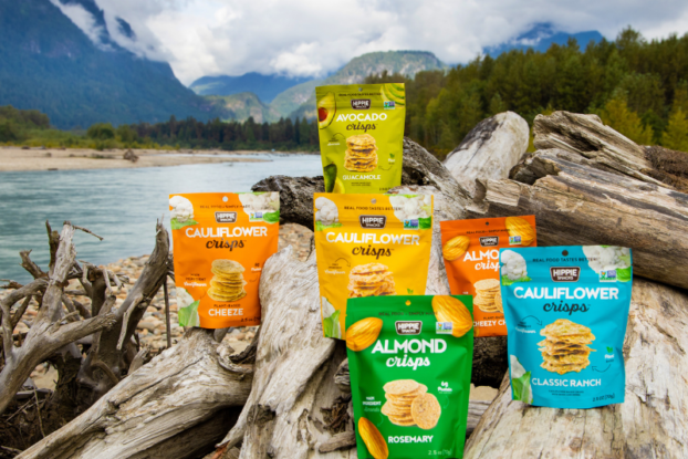 bags of crisps displayed in nature by hippie snacks