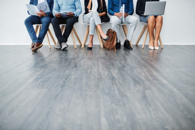 job candidates sitting in a row waiting