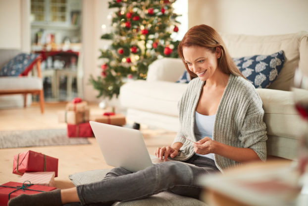 woman doing holiday shopping online
