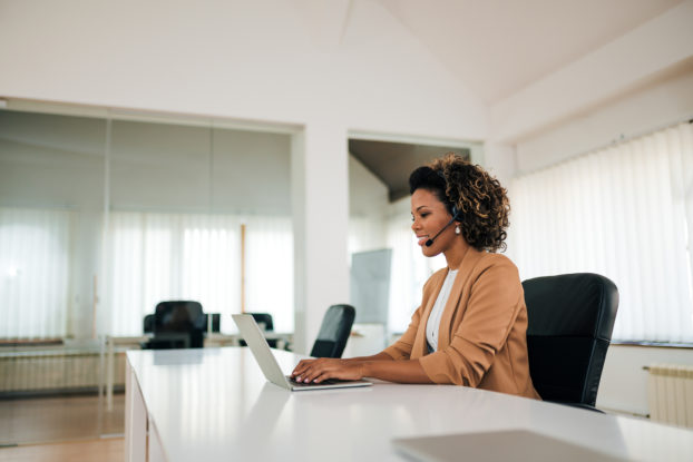 woman on laptop alone in office