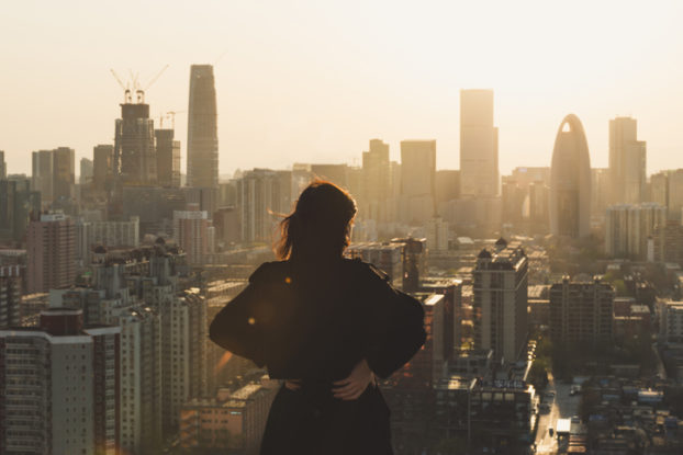 Woman staring at city skyline