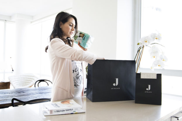 female shopper reaching into jetblack shopping bag