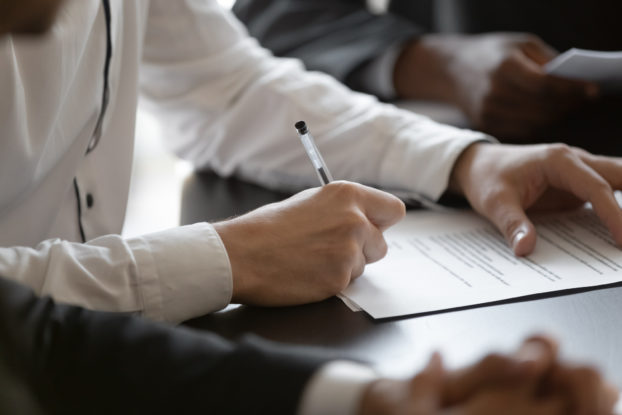 professional person signing contract