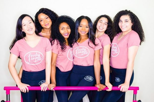 The dance instructors of California-based Lovely Leaps standing with a barre.