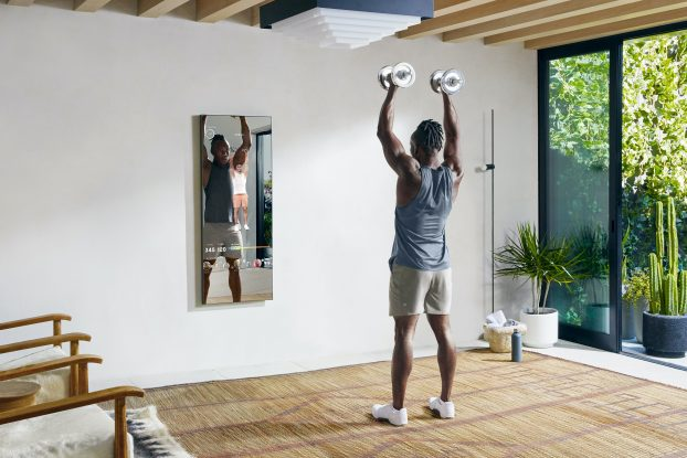man working out in house with Mirror