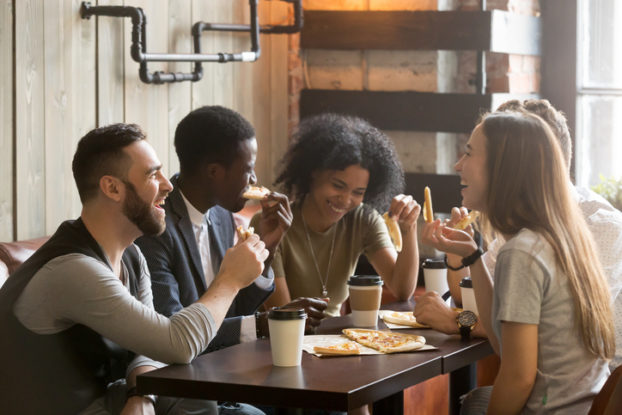 group of millennials sitting at coffee shop