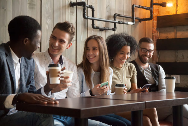 group of millennials in coffee shop