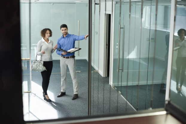 man and woman checking out a commercial real estate space