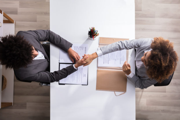 manager shaking hands with female applicant