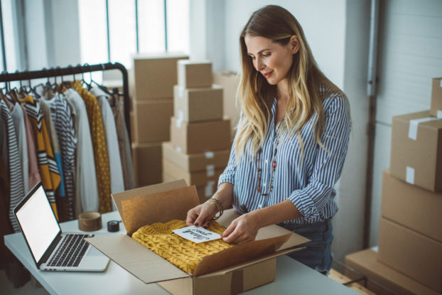 woman packing a box for shipment
