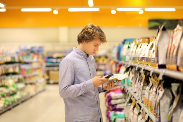 man in store checking price of item