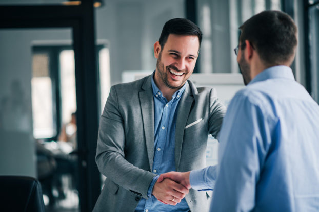 two men shaking hands at work