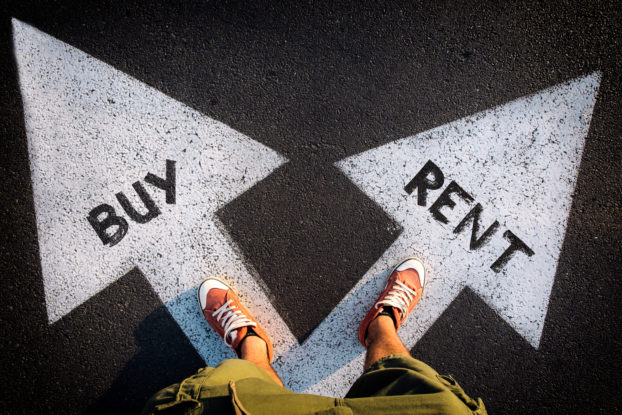 person standing on two arrows saying rent and buy