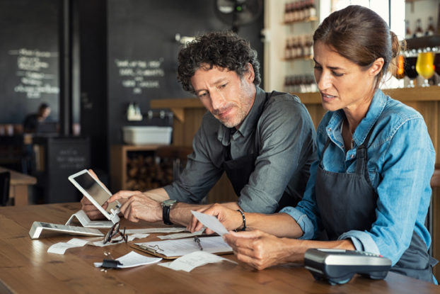 man and woman going over business paperwork