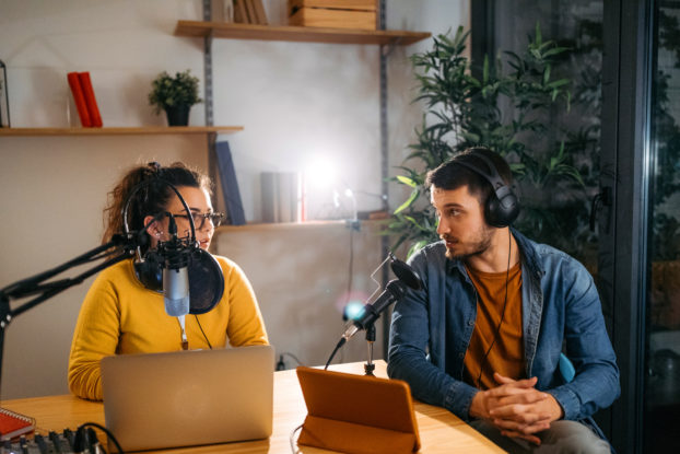 two people recording a podcast