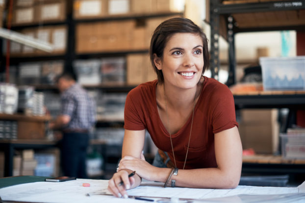 woman smiling over paperwork
