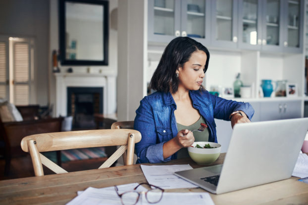 woman working from home checking her watch