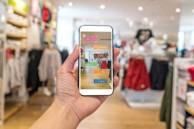 person holding phone showing augmented reality in shopping