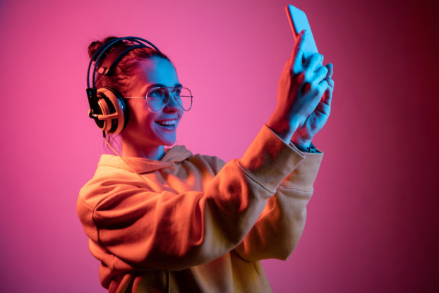 woman with headphones taking selfie