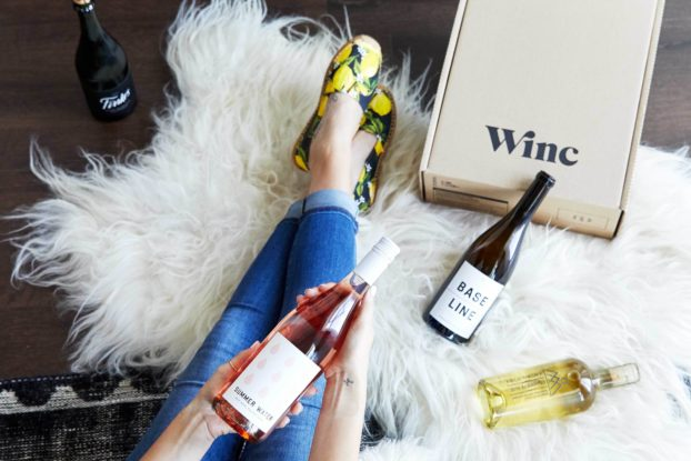 woman unboxing her winc wine box