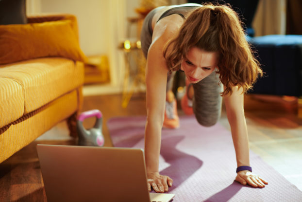 woman exercising at home virtually