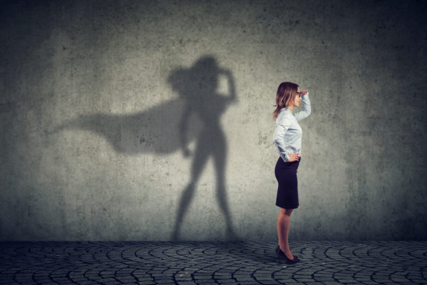 woman standing with superhero shadow