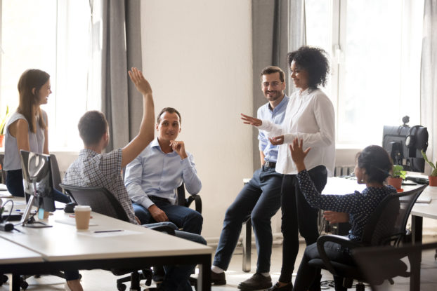 Team of employees together in a meeting.