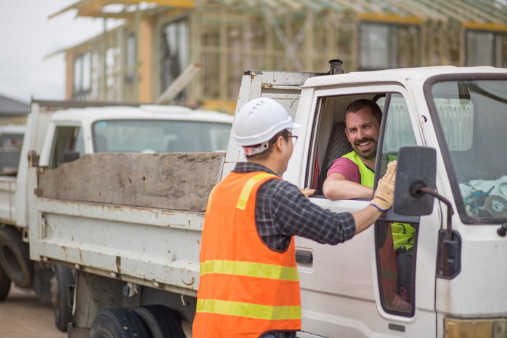 construction workers talking through truck window
